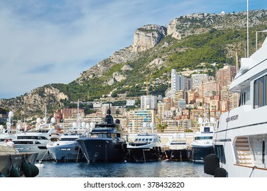Monaco, Monte-Carlo, Monaco Ville, 4 sept 2015: Panorama Port Hercules, the preparation of the yacht show MYS in September,  clear weather, sunny day, many yachts and boats, Prince's Palace of Monaco
