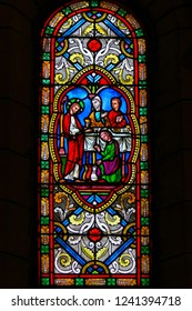 Monaco - November 13, 2018: Stained Glass in the Cathedral of Monaco, depicting the transformation of water into wine at the Marriage at Cana, Jesus' first miracle in the Gospel of John