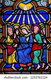 Monaco - November 13, 2018: Stained Glass in the Cathedral of Monaco depicting Mary and the Apostles at Pentecost
