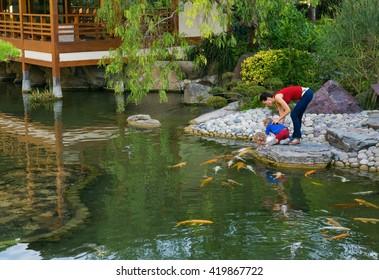MONACO - NOVEMBER 2, 2014: Mother with children in Japanese garden in Monte Carlo