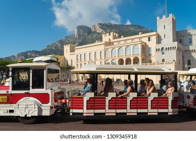 MONACO - OCTOBER 22, 2017: Train with tourists riding along the National Palace