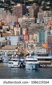 Monaco principality from the port, apartment buildings, block of flats, houses on a steep coastal mountain slope