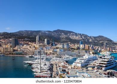 Monaco principality, yachts at Port of Hercules and city skyline by the Mediterranean Sea, southern Europe.