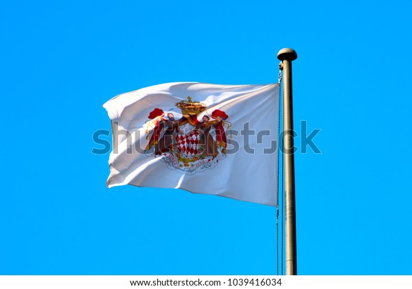 Monaco September 2017. flag with the coat of arms of Monaco over the prince's dwarf