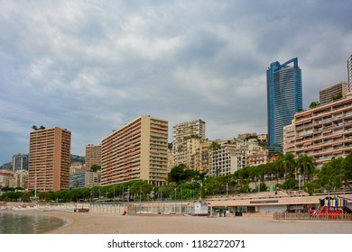 Monaco / Monaco — September 27, 2016: buildings in the Larvotto district of Monte Carlo, lined up along the beautiful sea promenade and Larvotto beach, the only beach of the state
