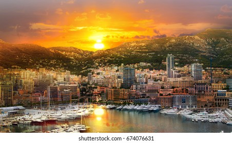 Monaco at sunset. Main marina of Monte Carlo with luxury yachts and sail boats at sunset