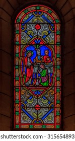Monaco Ville, Monaco - October 13, 2013: Stained glass in the Saint Nicholas Cathedral; 19th century romanesque Catholic cathedral, where Monegasque royalty the Grimaldi's, like Grace Kelly is burried