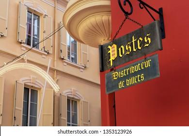 Monaco-Ville / Principality of Monaco - 31.08.2018: Historic post office sign of Monaco on red wall