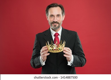 Monarchy attribute. Monarchy family traditions. Man bearded guy in suit hold golden crown symbol of monarchy. Become king ceremony. Award and achievement. Feeling superiority. Being superior human.