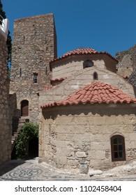 Monastery Agios Panteleimonas, Tilos Island, Greece. Ancient buildings, tiled roofs.