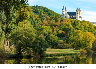 Monastery Arnstein with river Lahn in the Foreground on a beautiful day in autuum