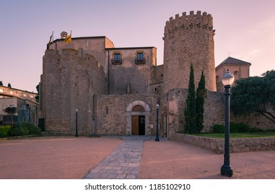 Monastery benedictine, a Romanesque medieval construction, in the mediterranean village of Sant Feliu de Guixols, Costa Brava, Girona province, Spain