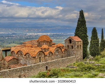 Monastery buildings in the medieval Byzantine ghost town-castle of Mystras, with city of Sparta in background Peloponnese, Greece