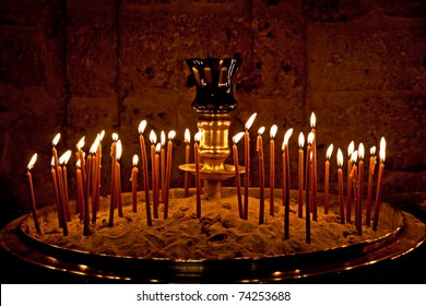 Monastery burning candles