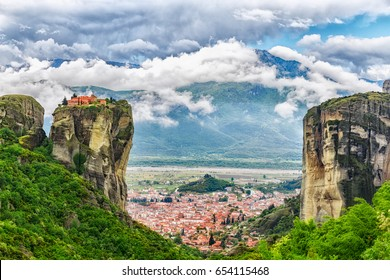 Monastery Holy Trinity, Meteora, Greece. UNESCO world heritage object. Epic landscape with temple at the edge of cliff at dramatic sky background.