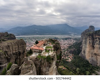 The monastery of Holy Trinity under dramatic clouds, Meteora, Greece