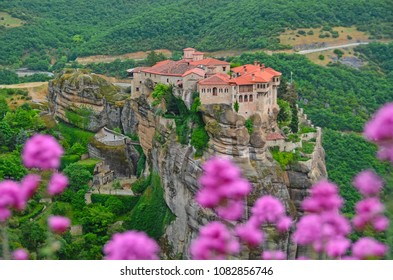 Monastery Meteora Greece. Stunning spring view with pink flowers.