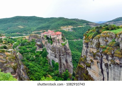 Monastery Meteora Greece. Stunning spring panoramic landscape. View at mountains and green forest. Unesco heritage list object.