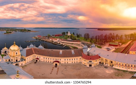 Monastery on island of lake Seliger, Russia. View on landscape from clock tower at sunset.