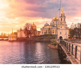 Monastery on island of lake Seliger, Russia. Stolobny Island is an island on Lake Seliger in the Tver Oblast. Sunset time.