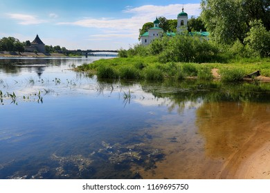 Monastery on the river bank in the summer. Traveling in Russia, Pskov