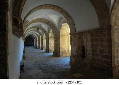 Monastery of Santa Clara a Nova, monument and historical historical patrimony, its cloister in Mannerist style and details of beautiful architecture, in the city of Coimbra, Portugal, June 2017.