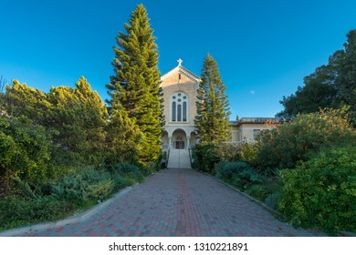 Monastery Of Silence - Latrun Trappist Monastery, Israel. The magnificent building of the temple is surrounded by a lush garden.