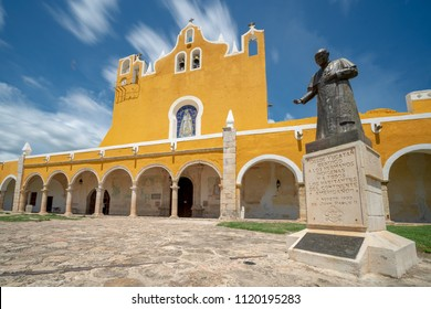Monastery and Statue in the Yellow City of Izamel in Yucatan Mexico / Long Exposure with Moving Clouds