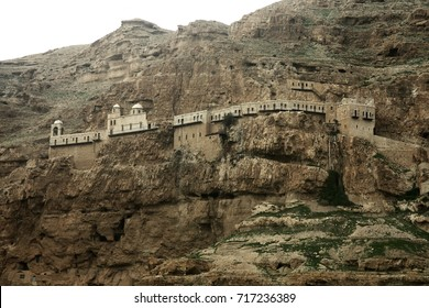 Monastery of Temptation on the Cliff Israel, Palestinian territories, Jericho: Monastery of temptation, on the mountain of temptation. Cave monastery on a steep wall.