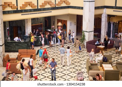 MONASTIR, TUNISIA, AFRICA-CIRCA MAY, 2012: Russian tourists check into hotel in lobby. People have vacation on public holiday at May. Interior of Dessole Bella Vista four stars hotel