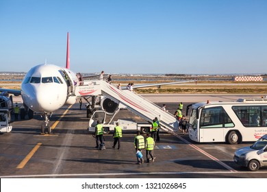 MONASTIR, TUNISIA, AFRICA-CIRCA MAY, 2012: Passengers come off the plane of Tunisair flight company. Airbus A319 with the number TS-IMK is arrived in Habib Bourguiba International Airport