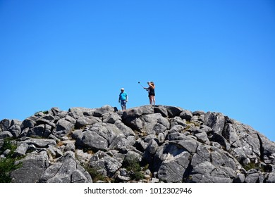 MONCHIQUE, PORTUGAL - JUNE 7, 2017 - Tourists on a mountain peak taking a selfie in the Monchique mountains, Foia, Algarve, Portugal, Europe, June 7, 2017.