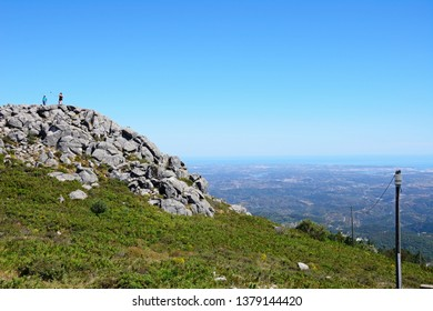 MONCHIQUE, PORTUGAL - JUNE 7, 2017 -  Elevated view across the Monchique mountains and countryside towards the coastline with tourists enjoying the setting, Foia, Algarve, Portugal, June 7, 2017.