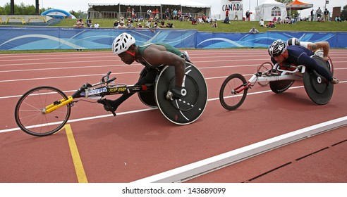 MONCTON, CANADA - June 22: Jean-Paul Compaore (left) and Michel Filteau compete in the 10,000-meter run wheelchair event at the Canadian Track & Field Championships June 22, 2013 in Moncton, Canada.