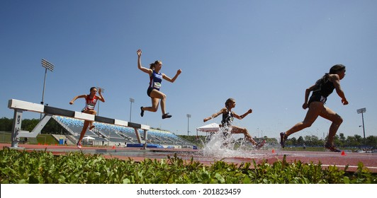 MONCTON, CANADA - June 28: Katie Robinson, Alycia Butterworth, Julie-Anne Staehli and Maria Bernard in the steeplechase at the Canadian Track & Field Championships June 28, 2014 in Moncton, Canada.