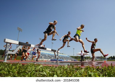 MONCTON, CANADA - June 28: Steeplechasers Chris Winter (top), Christopher Dulhanty, Matthew Hughes (9) and Taylor Milne (3) at Canadian Track & Field Championships June 28, 2014 in Moncton, Canada.