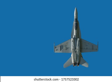 Moncton, NB, Canada - August 23, 2014: A Canadian F-18 (CF-118) Hornet fighter jet flied directly overhead. Bottom of plane visible. Room for text.