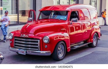 Moncton, New Brunswick, Canada - July 8, 2017 : Red 1951 GMC panel truck parked in downtown area of Moncton during 2017 Atlantic Nationals Automotive Extravaganza.