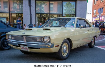 Moncton, New Brunswick, Canada - July 7, 2017 :  1970 Dodge Dart 340 Swinger at 2017 Atlantic Nationals Automotive Extravaganza drives in the downtown area of Moncton, New Brunswick.