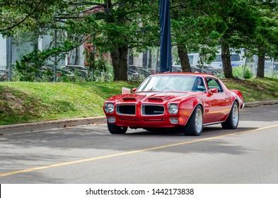 Moncton, New Brunswick, Canada - July 8, 2017 :  1971 Pontiac Firebird entering Centennial Park during 2017 Atlantic Nationals Automotive Extravaganza.