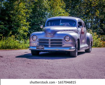 Moncton, New Brunswick, Canada - July 11, 2009 :  1946 Plymouth Special Deluxe entering  Centennial Park at  2009 Atlantic Nationals Automotive  Extravaganza.