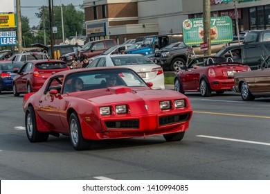 Moncton, New Brunswick, Canada - Saturday July 11, 2015 : Pontiac Firebird Trans Am cruises Mountain Rd Saturday evening at 2015 Atlantic Nationals Automotive Extravaganza.