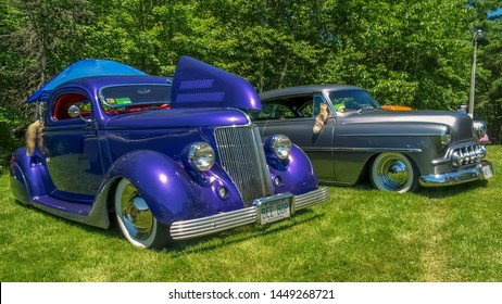 Moncton, New Brunswick - July 14, 2007.  Gorgeous pair of mild customs  - 1936 Ford & 1953 Chevy - parked in Centennial Park during 2007 Atlantic Nationals Automotive Extravaganza.