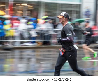 Monday, April 16 (Boston Massachusetts) A man is running to the finish line at the 122nd Boston Marathon.