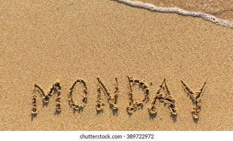 Monday - word drawn on the sand beach with the soft wave.