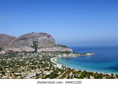 Mondello Beach lies between two cliffs called Monte Gallo and Monte Pellegrino. Mondello, Sicily, Italy.