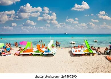 MONDELLO, ITALY - SEP 19, 2014: Unidentified people at the beach of Mondello on Sep 19, 2014 at Sicily. At the end of the 19th century Mondello grew into a favourite tourist destination.