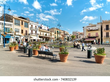 Mondello - Palermo, Sicily, Italy - October 9, 2017: People resting on the square in the center of Mondello, is a small seaside resort near center of city Palermo.
