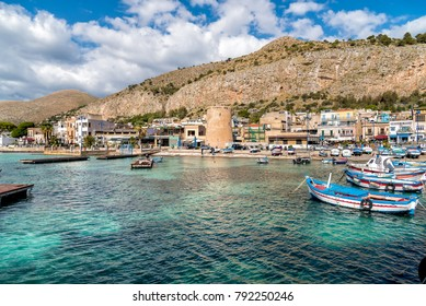 Mondello - Palermo, Sicily, Italy - October 9, 2017: Small port with fishing boats in the center of Mondello in Palermo.