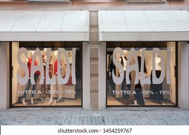 MONDOVI, ITALY - AUGUST 15, 2015: Shop windows during sales with saldi big writing in summer in Mondovi, Italy